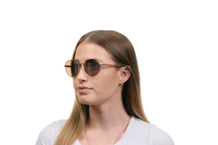 Woman wearing JORD Holly - Padauk & Rose Gold Titanium sunglasses
