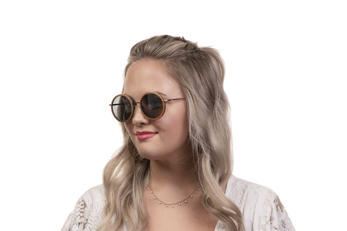 Woman wearing JORD Louie - Walnut & Vintage Bronze sunglasses